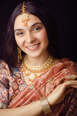 beauty sweet real indian girl in sari smiling on black