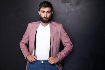 Elegant man with beard posing.