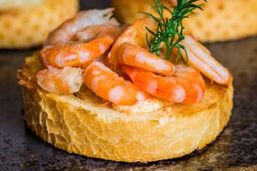 Tapas appetizers with shrimp sauce