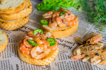 Tapas appetizers with shrimp on paper