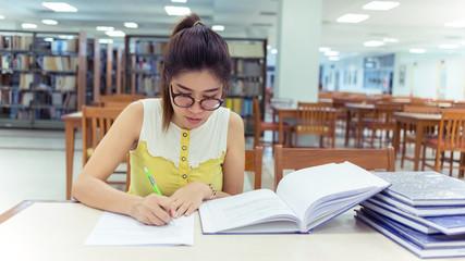 study education, woman writing a paper, working women