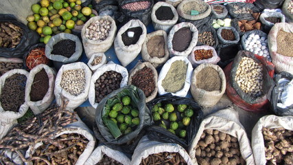 Fruit, grains, lumps and spices on market in Sumatra
