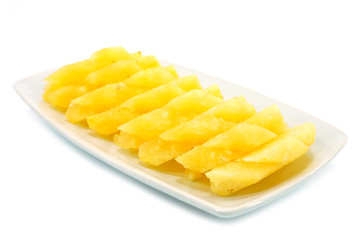 Pineapple slices in a white background.