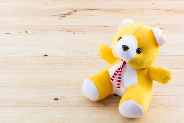 Yellow teddy bear toy.