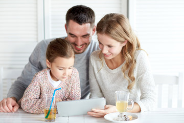 happy family with tablet pc at restaurant