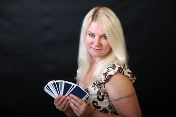 Fortune-teller / Blond woman with cards, black background