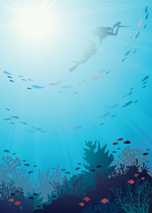 Underwater - coral reef and divers.