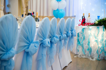 Wedding chairs with blue bows, Wedding Banquet, restaurant interior, decoration and design of wedding decoration.