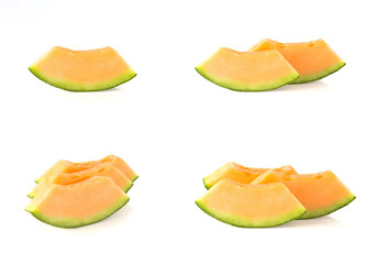 Melon, cut pieces on white background.