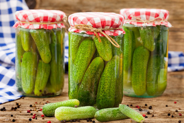 Jars of canned pickles with peppers