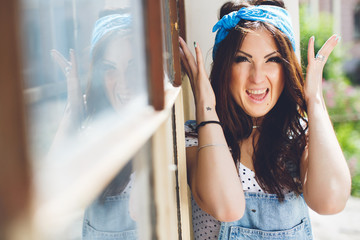 stylish brunette young girl going crazy