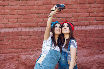 twins girls taking selfie with camera