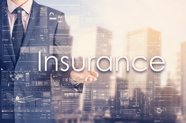 Businessman showing text by his hand: Insurance