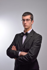 Portrait of young business man with arms crossed