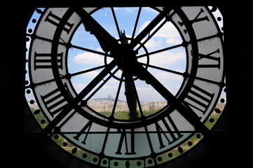 View through d'orsay clock tower in Paris, France