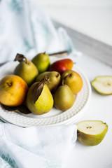 Autumn pears on white pastel background