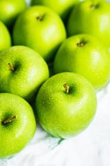 Bright green apples on white napkin