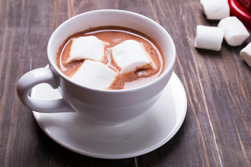 Fotobehang - Hot cocoa with marshmallows the wooden table