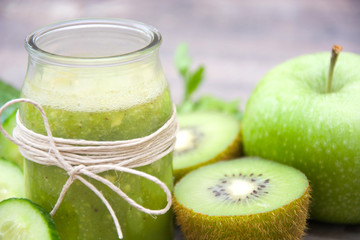 Green smoothie with cucumber,kiwi and apples