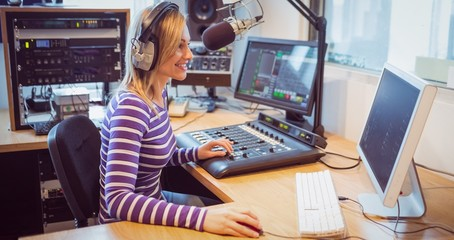 Female radio host broadcasting through microphone