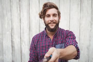 Portrait of hipster using selfie stick
