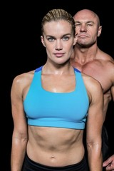 Portrait of muscular woman and man