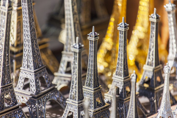 PARIS, FRANCE, on AUGUST 29, 2015. Trade in souvenirs. A souvenir in the form of the Eiffel Tower - a traditional gift from Paris