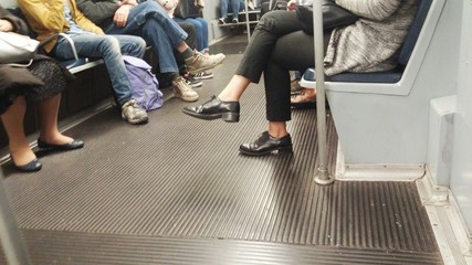 People on the metro going work