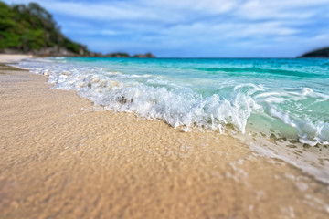 Tilt-Shift soft blur effect beautiful landscape blue sea white sand and waves on the beach during summer at Koh Miang island in Mu Ko Similan National Park, Phang Nga province, Thailand