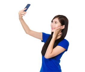 Asian woman take self photo by mobile phone