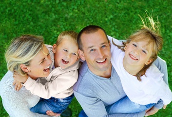 Happy family on a background of grass top view