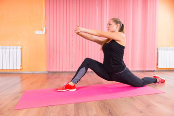 Woman in Deep Lunge Stretch with Arms Forward