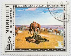 "MONGOLIA - CIRCA 1976: A stamp printed by the Mongolian Post is a reproduction of ""Awakening at a pasture"" by O.Tsevegzhav, a Mongolian artist, circa 1976"