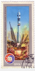 USSR - CIRCA 1975: A postage stamp printed in the USSR shows Apollo-Soyuz Test Project - launch of carrier rocket with Soyuz spacecraft, circa 1975