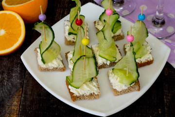Appetizer canape sandwich with cucumber and cheese curd