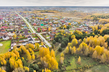 Aerial view onto rural street in autumn. Russia