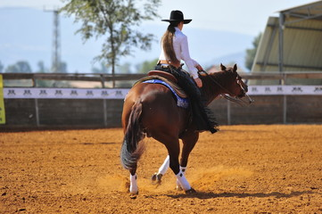 Girl is riding a horse