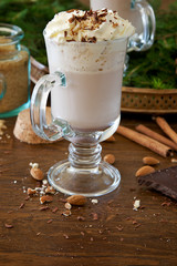 Cocoa with whipped cream, nuts and chocolate