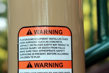 Warning label sign on playground equipment for safety
