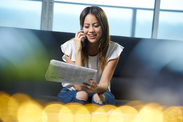 Woman Phone Calling For Job Announcement On Newspaper