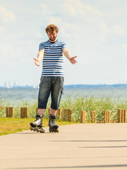 Young man rollerblading outdoor on sunny day