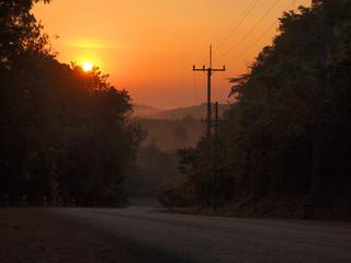 Autumn sunrise road