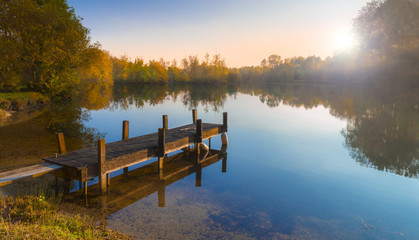 Photo sur Aluminium Lac / Etang Wooden Jetty on a Becalmed Lake at Sunset