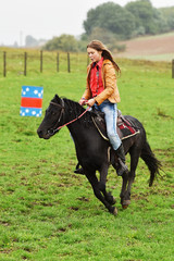 Girl barrel racing