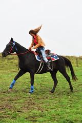 Girl barrel racing