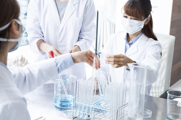 People are developing a new product in the laboratory