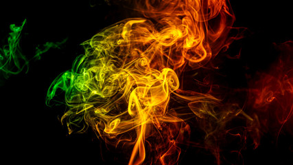 Abstract yellow - green - orange smoke from aromatic sticks.