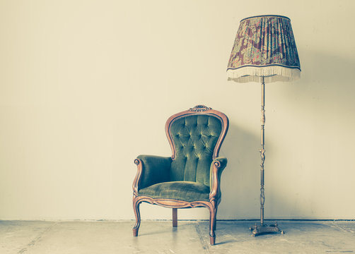 Vintage and antique chair with white wall background
