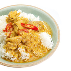 Red curry chicken and white rice on white background