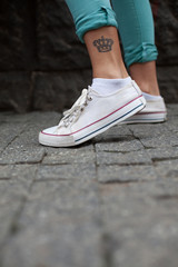 Modern girl with a tattoo on her leg